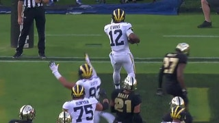 Michigan's Chris Evans scores on a 10-yd touchdown run
