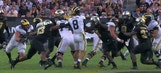 Michigan extends its lead with an incredible pass and 1-yd run to score