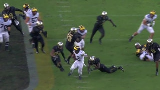 Michigan's Chris Evans scores on a 49-yd touchdown run to seal the Wolverines' 38-10 win