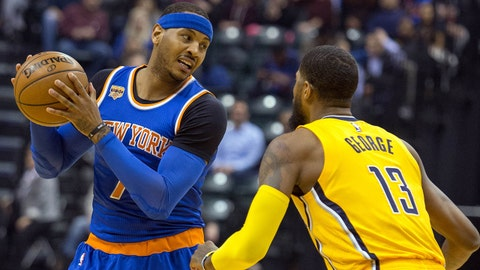 Jan 7, 2017; Indianapolis, IN, USA; New York Knicks forward Carmelo Anthony (7) looks to dribble the ball while Indiana Pacers forward Paul George (13) defends in the first quarter of the game at Bankers Life Fieldhouse. Mandatory Credit: Trevor Ruszkowski-USA TODAY Sports