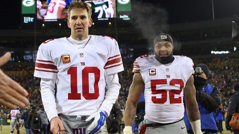 Jan 8, 2017; Green Bay, WI, USA;  New York Giants quarterback Eli Manning (10) and outside linebacker Jonathan Casillas (52) leave the field after the NFC Wild Card playoff football game against the Green Bay Packers at Lambeau Field. Mandatory Credit: Jerry Lai-USA TODAY Sports