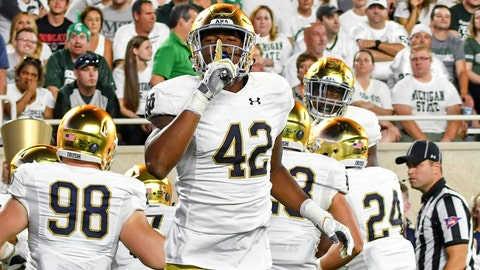 Sep 23, 2017; East Lansing, MI, USA; Notre Dame Fighting Irish defensive lineman Julian Okwara (42) gestures to the MSU crowd after Notre Dame scored a touchdown on an interception return in the first quarter against the Michigan State Spartans at Spartan Stadium. Mandatory Credit: Matt Cashore-USA TODAY Sports