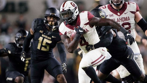 Sep 23, 2017; Waco, TX, USA; Oklahoma Sooners running back Trey Sermon (4) runs for a first down against the Baylor Bears during the second half at McLane Stadium. The Sooners defeat the Bears 49-41. Mandatory Credit: Jerome Miron-USA TODAY Sports