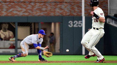 Sep 16, 2017; Atlanta, GA, USA; New York Mets second baseman Gavin Cecchini (2) fields a ball and throws to first for the final out to defeat the Atlanta Braves at SunTrust Park. Mandatory Credit: Adam Hagy-USA TODAY Sports