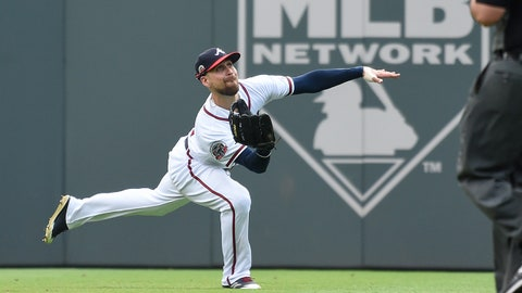 Sep 17, 2017; Atlanta, GA, USA; Atlanta Braves center fielder Ender Inciarte (11) makes a running catch on a ball hit by New York Mets catcher Kevin Plawecki (not shown) during the fifth inning at SunTrust Park. Mandatory Credit: Dale Zanine-USA TODAY Sports