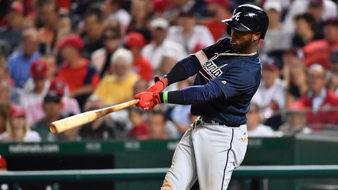 Sep 13, 2017; Washington, DC, USA; Atlanta Braves second baseman Ozzie Albies (1) hits an RBI single against the Washington Nationals during the fifth inning at Nationals Park. Mandatory Credit: Brad Mills-USA TODAY Sports