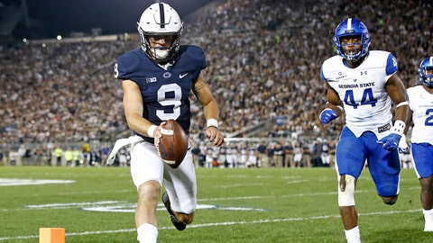 Penn State quarterback Trace McSorley (9) runs in for a touchdown against Georgia State during the first half of an NCAA college football game in State College, Pa., Saturday, Sept. 16, 2017. (AP Photo/Chris Knight)