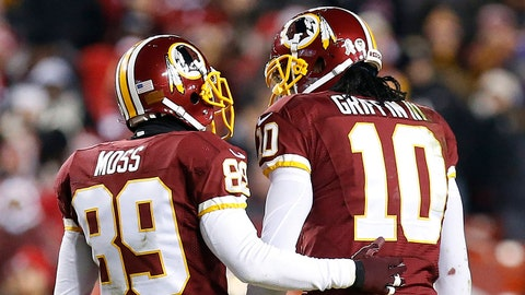 Nov 25, 2013; Landover, MD, USA; Washington Redskins wide receiver Santana Moss (89) checks on quarterback Robert Griffin III (10) after Griffin was hit against the San Francisco 49ers in the second quarter at FedEx Field. The 49ers won 27-6. Mandatory Credit: Geoff Burke-USA TODAY Sports