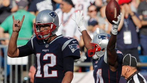 Sep 24, 2017; Foxborough, MA, USA; New England Patriots quarterback Tom Brady (12) signals for two point conversion as wide receiver Brandin Cooks (14) reacts after his game winning touchdown catch against the Houston Texans in the second half at Gillette Stadium. Mandatory Credit: David Butler II-USA TODAY Sports