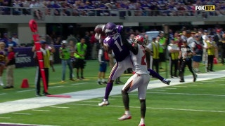 Stefon Diggs elevates to haul in Case Keenum's 17-yard TD pass