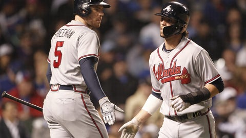Aug 31, 2017; Chicago, IL, USA; Atlanta Braves shortstop Dansby Swanson (7) celebrates with first baseman Freddie Freeman (5) after scoring during the fifth inning against the Chicago Cubs t Wrigley Field. Mandatory Credit: Caylor Arnold-USA TODAY Sports