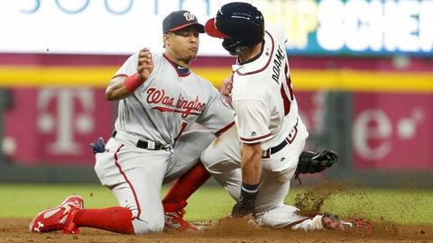 Sep 19, 2017; Atlanta, GA, USA; Atlanta Braves left fielder Lane Adams (16) steals a base past Washington Nationals second baseman Wilmer Difo (1) in the fifth inning at SunTrust Park. Mandatory Credit: Brett Davis-USA TODAY Sports