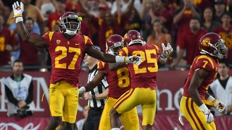Sep 16, 2017; Los Angeles, CA, USA;  USC Trojans cornerback Ajene Harris (27) celebrates a stoppage on 3rd down in the first half of the game against the Texas Longhorns at Los Angeles Memorial Coliseum. Mandatory Credit: Jayne Kamin-Oncea-USA TODAY Sports