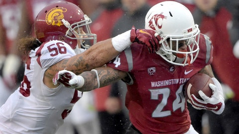 Nov 1, 2014; Pullman, WA, USA; Washington State Cougars running back Theron West (right) is defended by linebacker Anthony Sarao (56) in the third quarter at Martin Stadium. USC defeated Washington State 44-17.  Mandatory Credit: Kirby Lee-USA TODAY Sports