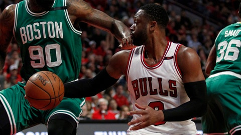 Apr 21, 2017; Chicago, IL, USA; Chicago Bulls guard Dwyane Wade (3) is defended by Boston Celtics forward Amir Johnson (90) during the second quarter in game three of the first round of the 2017 NBA Playoffs at United Center. Mandatory Credit: Caylor Arnold-USA TODAY Sports