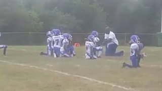 8-and-under youth football team takes knee during the national anthem