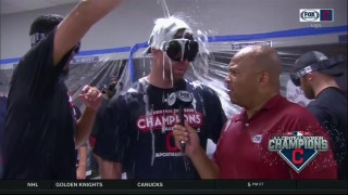 Corey Kluber gets doused with champagne, doesn't miss a beat