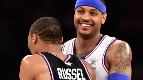 February 15, 2015; New York, NY, USA; Eastern Conference forward Carmelo Anthony of the New York Knicks (7) hugs Western Conference guard Russell Westbrook of the Oklahoma City Thunder (0) during the second half of the 2015 NBA All-Star Game at Madison Square Garden. The West defeated the East 163-158. Mandatory Credit: Bob Donnan-USA TODAY Sports