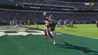 Odell Beckham Jr. miraculously hangs on to bobbled ball for a TD, then raises his fist in the air