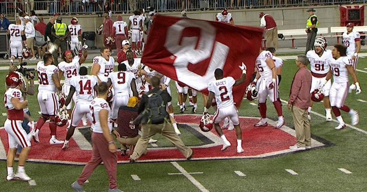 6092e2733bf Baker Mayfield plants an Oklahoma flag at midfield after crushing Ohio State  in Columbus