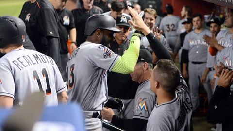 Sep 22, 2017; Phoenix, AZ, USA; Miami Marlins left fielder Marcell Ozuna (13) celebrates with teammates after hitting a home run against the Arizona Diamondbacks during the fourth inning at Chase Field. Mandatory Credit: Joe Camporeale-USA TODAY Sports