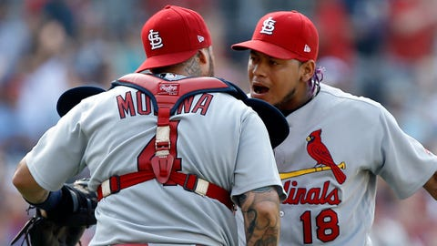 The Cardinals would like to see Carlos Martinez celebrating with Yadier Molina at the end of Friday's series opener in Chicago.	 AP