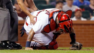 WATCH: Yadi leaves game after taking back-to-back foul balls off the mask