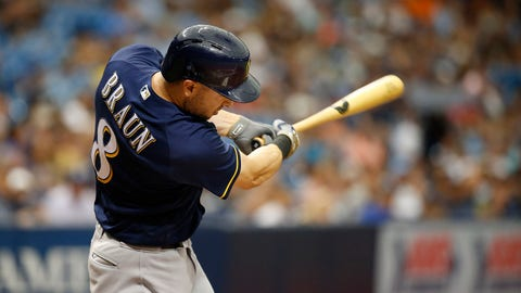 Brewers pound Cubs to close the gap
