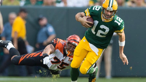 Sep 24, 2017; Green Bay, WI, USA; Cincinnati Bengals defensive end Jordan Willis (75) tries to tackle Green Bay Packers quarterback Aaron Rodgers (12) during the second quarter at Lambeau Field. Mandatory Credit: Jeff Hanisch-USA TODAY Sports