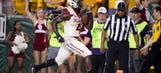 No. 3 Oklahoma overcomes Baylor 49-41 for 14th straight win