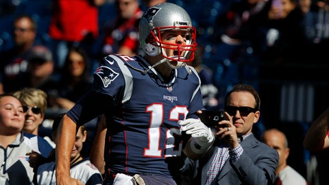 Oct 1, 2017; Foxborough, MA, USA; New England Patriots quarterback Tom Brady (12) runs onto the field during warm ups prior to a game against the Carolina Panthers at Gillette Stadium. Mandatory Credit: Stew Milne-USA TODAY Sports