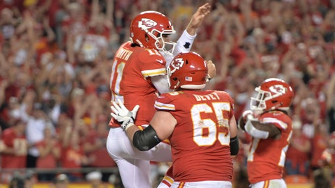 Oct 2, 2017; Kansas City, MO, USA; Kansas City Chiefs offensive tackle Jordan Devey (65) congratulates quarterback Alex Smith (11) after Smith scores during the second half against the Washington Redskins at Arrowhead Stadium. Mandatory Credit: Denny Medley-USA TODAY Sports
