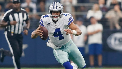 Oct 1, 2017; Arlington, TX, USA; Dallas Cowboys quarterback Dak Prescott (4) scrambles for a first down in the fourth quarter against the Los Angeles Rams at AT&T Stadium. Mandatory Credit: Tim Heitman-USA TODAY Sports