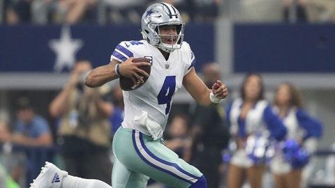Oct 1, 2017; Arlington, TX, USA; Dallas Cowboys quarterback Dak Prescott (4) scrambles in the second quarter against the Los Angeles Rams at AT&T Stadium. Mandatory Credit: Matthew Emmons-USA TODAY Sports