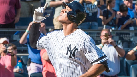 Sep 25, 2017; Bronx, NY, USA; New York Yankees right fielder Aaron Judge (99) gestures after hitting his record breaking 50th home run against the Kansas City Royals during the seventh inning of the game at Yankee Stadium. Mandatory Credit: Gregory J. Fisher-USA TODAY Sports