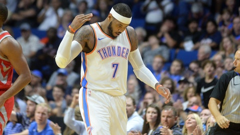Oct 3, 2017; Tulsa, OK, USA; Oklahoma City Thunder forward Carmelo Anthony (7) reacts after hitting a three point shot against the Houston Rockets during the second quarter at the BOK Center. Mandatory Credit: Mark D. Smith-USA TODAY Sports