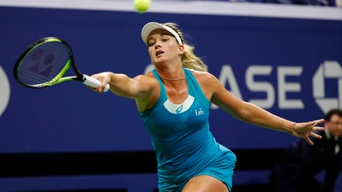 CoCo Vandeweghe, of the United States, returns a shot from Madison Keys, of the United States, during the semifinals of the U.S. Open tennis tournament, Thursday, Sept. 7, 2017, in New York. (AP Photo/Adam Hunger)