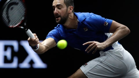 Europe's Marin Cilic returns a ball to World's Frances Tiafoe during their Laver Cup tennis match in Prague, Czech Republic, Friday, Sept. 22, 2017. The competition pits a team of the best six European players against the top six from the rest of the world. It is named after Australian tennis legend Rod Laver. (AP Photo/Petr David Josek)
