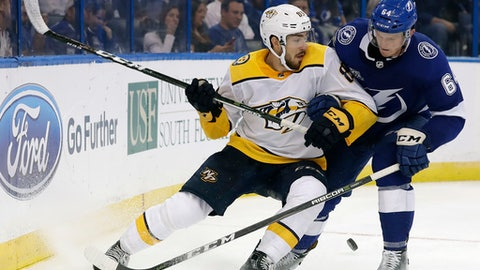 Tampa Bay Lightning defenseman Matthew Spencer (64) takes Nashville Predators center Frederick Gaudreau (89) off the puck during the third period of an NHL preseason hockey game Friday, Sept. 22, 2017, in Tampa, Fla. (AP Photo/Chris O'Meara)