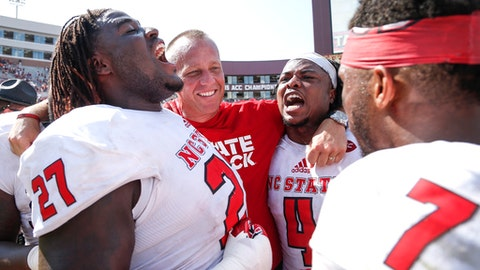 TALLAHASSEE, FL - SEPTEMBER 23: Defensive Tackle Justin Jones #27, Head Coach Dave Doeren, Linebacker Jerod Fernandez #4 and Runningback Nyheim Hines #7 of the North Carolina Wolfpack celebrate after the game against the Florida State Seminoles at Doak Campbell Stadium on Bobby Bowden Field on September 23, 2017 in Tallahassee, Florida. NC State defeated #12 ranked Florida State 27 to 21. (Photo by Don Juan Moore/Getty Images)
