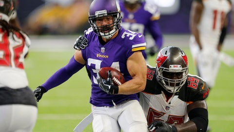 Minnesota Vikings strong safety Andrew Sendejo (34) is tackled by Tampa Bay Buccaneers offensive tackle Demar Dotson (69) after intercepting a pass during the second half of an NFL football game, Sunday, Sept. 24, 2017, in Minneapolis. (AP Photo/Jim Mone)