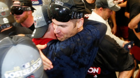 Minnesota Twins' Joe Mauer, right, and a teammate embrace early Thursday, Sept. 28, 2017, in Cleveland. The Twins earned an AL wild-card berth after the Los Angeles Angels lost to the Chicago White Sox. The Twins had lost 4-2 to the Cleveland Indians on Wednesday night. (AP Photo/Ron Schwane)