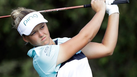 FILE - In this Sept. 9, 2017, file photo, Brooke Henderson of Canada watches her tee shot on the fourth hole during the final round of the Indy Women in Tech Championship golf tournament, in Indianapolis. Henderson and Jodi Ewart Shadoff of England shot 7-under 65 on Thursday, Sept. 28, 2017, to share the lead in the New Zealand Women's Open. (AP Photo/Darron Cummings, File)