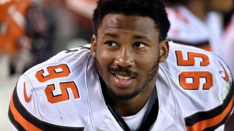 FILE - In this Aug. 10, 2017, file photo, Cleveland Browns defensive end Myles Garrett sits on the bench during the first half of an NFL preseason football game against the New Orleans Saints in Cleveland. Garrett, the No. 1 overall pick in this year's NFL draft, is back practicing after missing Cleveland's first three games with a sprained right ankle. Garrett has been out since Sept. 6, when he hurt his ankle when a teammate fell on it.  (AP Photo/David Richard, File)