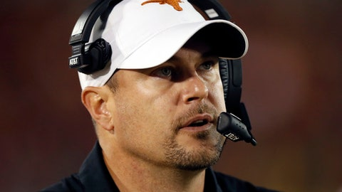 Texas coach Tom Herman watches from the sideline during the second half of an NCAA college football game against Iowa State, Thursday, Sept. 28, 2017, in Ames, Iowa. Texas won 17-7. (AP Photo/Charlie Neibergall)