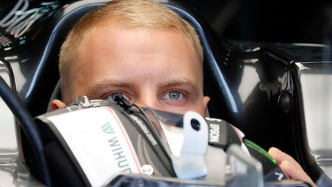 Mercedes driver Valtteri Bottas of Finland sits in his car at garage during the first practice session at the Sepang International Circuit for the Malaysian Formula One Grand Prix in Sepang, Malaysia, Friday, Sept. 29, 2017. (AP Photo/Vincent Thian)