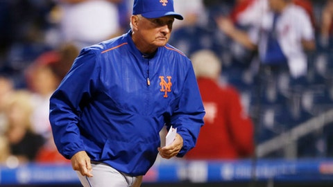 New York Mets manager Terry Collins runs to the dugout before the start of a baseball game against the Philadelphia Phillies, Friday, Sept. 29, 2017, in Philadelphia. (AP Photo/Laurence Kesterson)