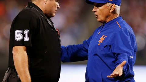 New York Mets manager Terry Collins, right, argues with umpire Marvin Hudson (51) after a warning was given to relief pitcher Hansel Robles in the sixth inning of a baseball game against the Philadelphia Phillies, Friday, Sept. 29, 2017, in Philadelphia. (AP Photo/Laurence Kesterson)