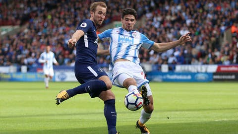 Tottenham Hotspur's Harry Kane, left, and Huddersfield Town's Christopher Schindler battle for the ball during the English Premier League soccer match between Huddersfield Town and Tottenham Hotspur at the John Smith's Stadium, Huddersfield, England. Saturday, Sept. 30, 2017 (Nigel French/ PA Via AP)