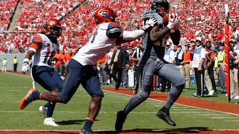 North Carolina State wide receiver Stephen Louis (12) beats Syracuse defensive back Evan Foster (14) for a 20-yard touchdown reception during the first half  of an NCAA college football game at Carter-Finley Stadium in Raleigh, N.C., Saturday, Sept. 30, 2017. (Ethan Hyman/The News & Observer via AP)